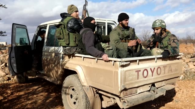 rebel fighters fired toward syrian pro regime forces tuesday in the countryside of idlib province currently dominated by a former al-qaeda affiliate... - rebellion stock videos & royalty-free footage