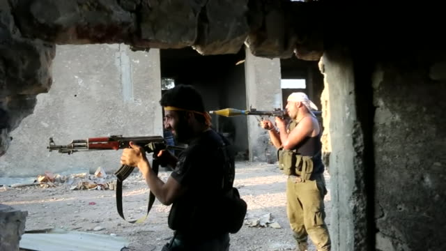 Rebel fighters firing weapons in Aleppo Syria