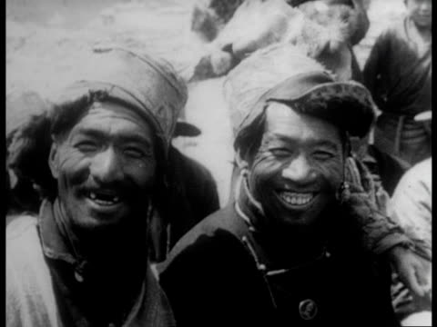 rebel landowners are stripped of land and the serfs are 'freed' / fields are plowed by joyous tibetan peasants - tibet stock videos & royalty-free footage
