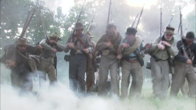 Rebel soldiers walk into an explosion on the battlefield.