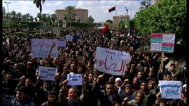 battle for control of zawiyah t27021102 zawiya ext gvs antigovernment supporters celebrating freedom from gaddafi at rally in city centre... - az zawiyah stock videos & royalty-free footage