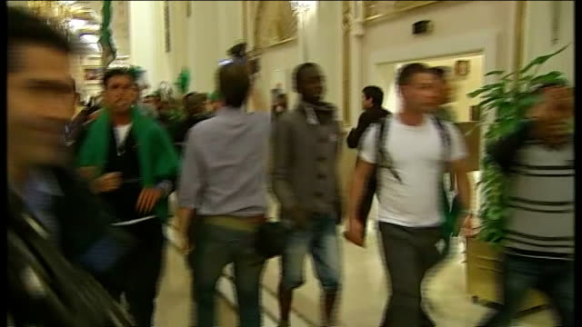 colonel gaddafi announces ceasefire as un resolution on libya announced tripoli int various shots of large group of progaddafi supporters chanting... - ceasefire stock videos and b-roll footage