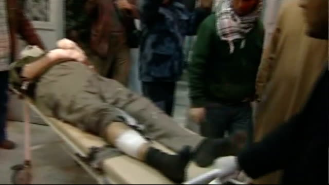 colonel gaddafi takes back town of zawiyah libya ras lanuf int heavily bandaged man wheeled along in hospital man with burns to face and bandaged... - az zawiyah stock videos & royalty-free footage