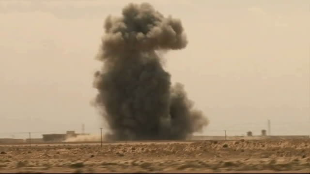 colonel gaddafi takes back town of zawiyah rebels diving for cover reporter to camera dust rising from recently bombed area plume of smoke rising... - az zawiyah stock videos & royalty-free footage