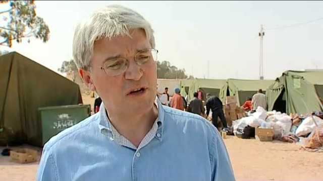 fall in number of people at border crossing causes concern International Development Secretary Andrew Mitchell MP talking with refugee at temporary...