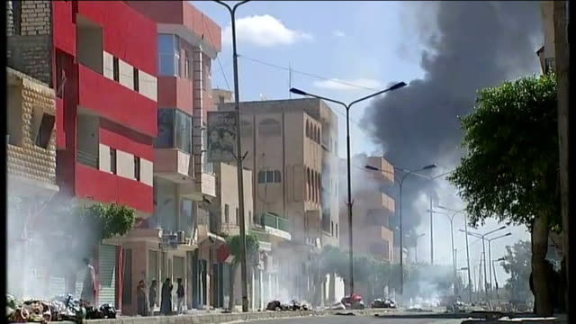 government troops and rebels fight for control of zawiyah libya zawiyah ext general view of black smoke rising from row of buildings black smoke... - az zawiyah stock videos & royalty-free footage