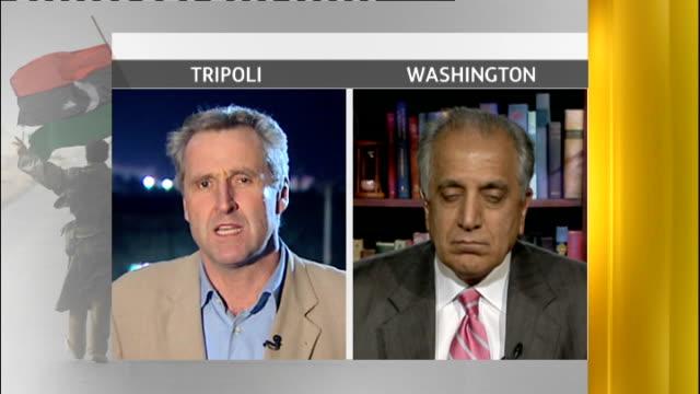 international diplomacy; libya: tripoli: ext / night zalmay khalilzad 2 way interview from washington sot - diplomacy stock videos & royalty-free footage
