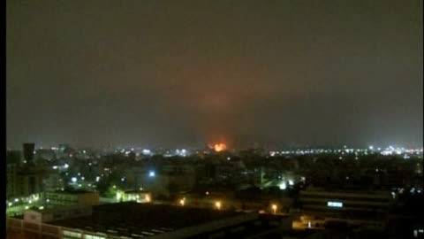vidéos et rushes de action intensifies; libya: tripoli: ext / night various of city skyline as bombs explode sot wide shot of smoke and flames rising from building... - terrorisme