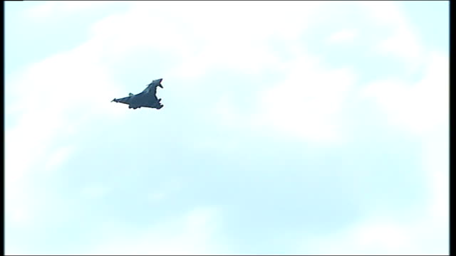 raf pilots report on their mission into libyan airspace ground to air views of british typhoon jet flying in cloudy sky - raf stock videos and b-roll footage