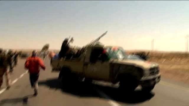 rebels request more military assistance from the un coalition; libya: eastern libyan desert: ext various views of rebels dropping to ground for cover... - request stock videos & royalty-free footage
