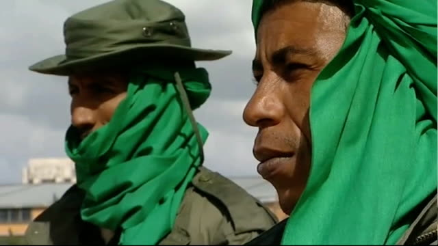 refugee crisis / colonel gaddafi prepares for fightback; libya: tripoli: ext gvs tanks on street and soldier wearing green scarf on top of tank tank... - top of the pops stock videos & royalty-free footage