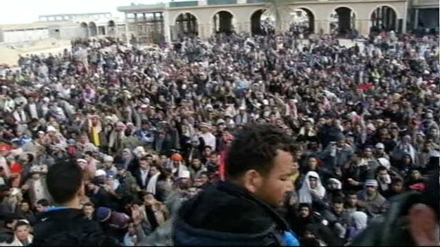 Refugee crisis / Colonel Gaddafi prepares for fightback LIBYA / TUNISIA BORDER Ras Ajdir High Angle shot of mass of foreign workers trying to...