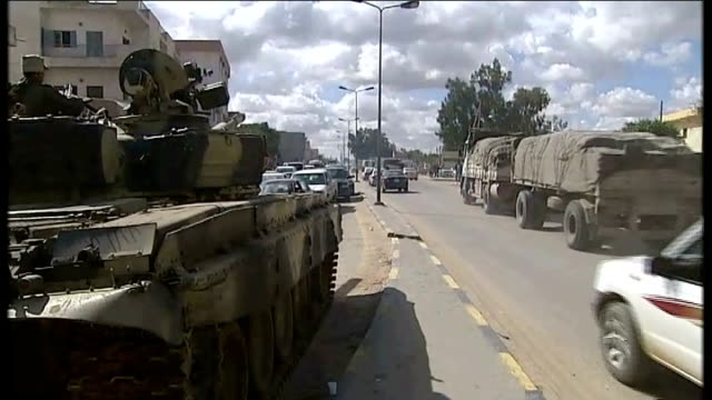 tripoli preparing for siege during lull in fighting libya en route to tripoli shots along road on outskirts of tripoli passing armoured vehicles... - poster stock videos & royalty-free footage