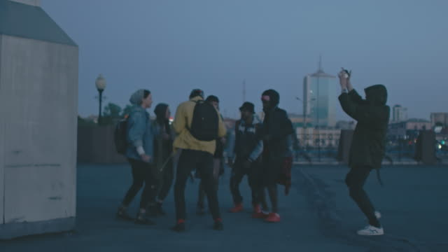 Rebellious young people dancing on roof