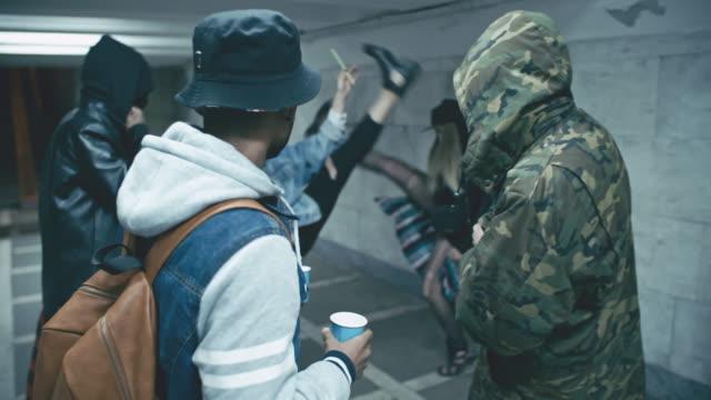Rebellious young people having fun inside underground walkway