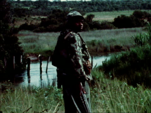 Duso Soldiers lined up One soldier stands more soldiers by river 2 soldiers with equipment more soldiers on mudbank One cleans gun pan mortar Mortar...