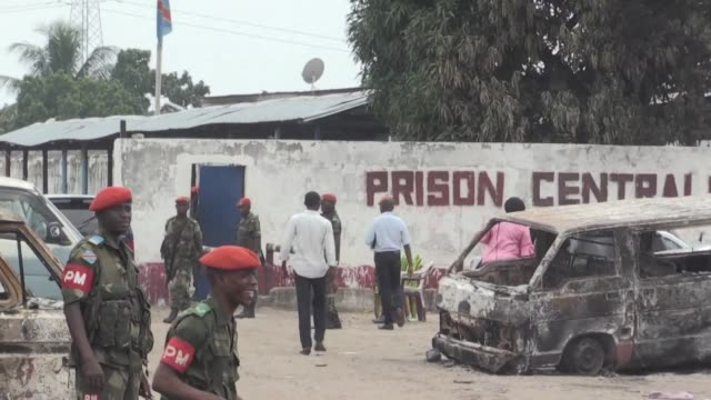 Rebels from an outlawed political religious group staged an attack on Kinshasa's central prison Wednesday freeing their leader and other prisoners...