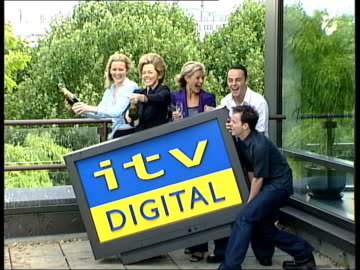rebranding; itn england: london: ext itv celebrities ant and dec, mary nightingale, gaby yorath and tracie shaw posing with mock widescreen tv... - mary nightingale stock videos & royalty-free footage