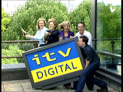 london ext itv celebrities ant and dec mary nightingale gaby yorath and tracie shaw posing with mock widescreen tv carrying logo for 'itv digital'... - メアリー ナイチンゲール点の映像素材/bロール
