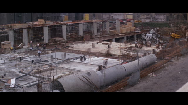 1964 - rebuilding of london after wwii - wiederaufbau stock-videos und b-roll-filmmaterial