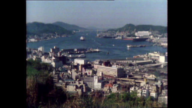 rebuilt nagasaki harbour with boats and shipyard; 1981 - 大量破壊兵器点の映像素材/bロール