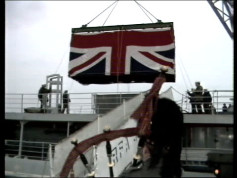 re-burials; night england: southampton: marchwood: sir bedevere at dockside rope put over holders on dockside wet day lms container with union jack... - union army stock videos & royalty-free footage