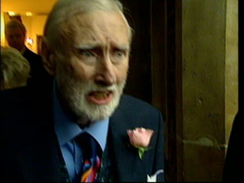 receives honorary knighthood; bbc pool england: london: st james' palace: ext comedian spike milligan towards from building after recieving honorary... - spike milligan stock videos & royalty-free footage
