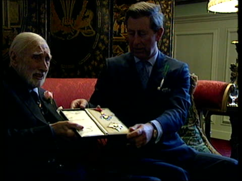 receives honorary knighthood; bbc pool england: london: st james' palace: int comedian spike milligan posing for photocall with prince charles, the... - spike milligan stock videos & royalty-free footage