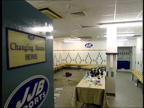 int cms 'home' on changing room door at wigan sports stadium as opens to show leftover mess from celebrations when wigan won promotion to premiership... - sports poster stock videos & royalty-free footage