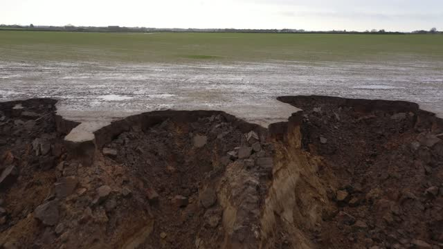 recent landslip on the cliff edge and beach in the village of happisburgh on january 27, 2021 in happisburgh, england. erosion of the norfolk sandy... - cliff stock videos & royalty-free footage