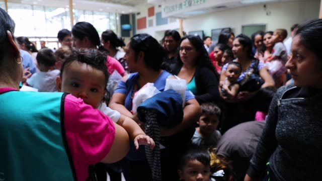 recently arrived migrant children play with family and volunteer children at the catholic charities humanitarian respite center on june 21, 2018 in... - mcallen texas stock videos & royalty-free footage