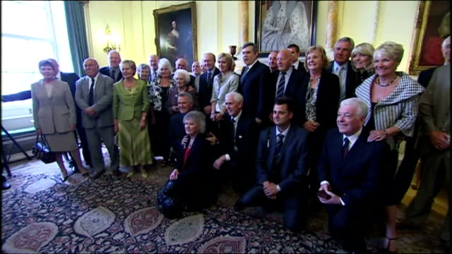 reception at 10 downing st for 1966 world cup winning england football team. shows interior shots gordon brown posing for photograph with the 1966... - 1966 stock videos & royalty-free footage