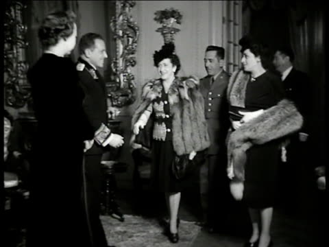 reception at russian embassy in mexico ws soviet union ambassador constantine oumansky wife greeting shaking hands w/ guests cu oumansky ms oumansky... - embassy stock videos and b-roll footage