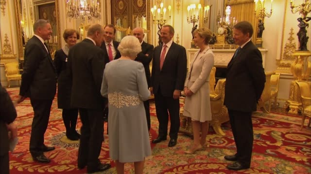 reception for civil service awards winners; england: london: int queen elizabeth ii and prince philip shake hands with award winners / award winners... - julie etchingham stock videos & royalty-free footage