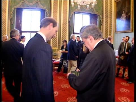 vídeos de stock, filmes e b-roll de reception for fifty former duke of edinburgh awards scheme participants england london buckingham palace int gvs prince philip duke of edinburgh... - doe