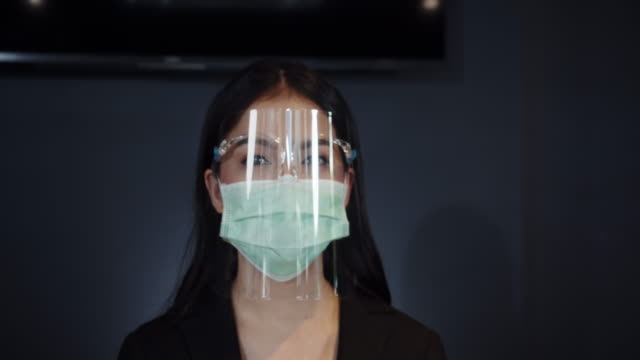 reception hotel standing safety with medical face mask - overworked stock videos & royalty-free footage