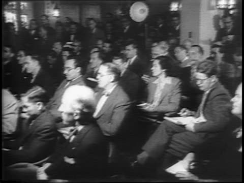 reception line / montage of press conference journalists running to phone booths telegraph operators communiques passing through censors - conference phone stock videos & royalty-free footage