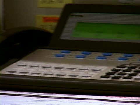 receptionist's desk - festnetzanschluss stock-videos und b-roll-filmmaterial