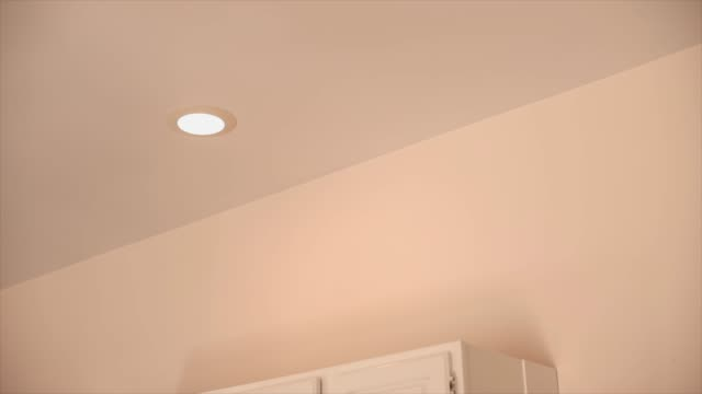 recessed ceiling light fixture turns on - cupboard stock videos & royalty-free footage