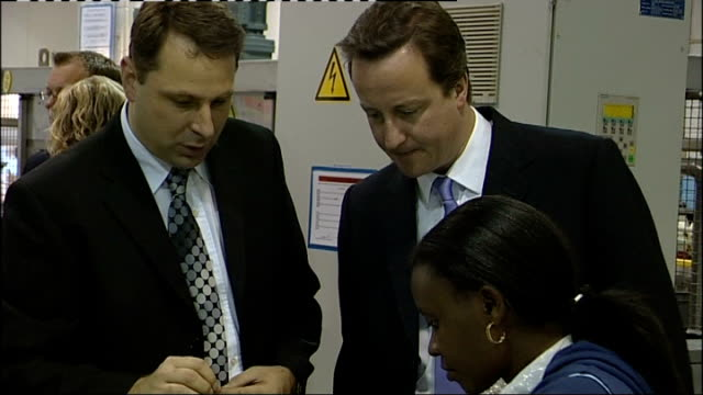 British economy shrinks 05% Oxfordshire Oxford David Cameron MP watching woman at work in factory David Cameron MP interview SOT This is the day the...