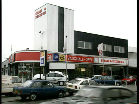 Car Sales Price Cuts ENGLAND Luton MS Shaw Kilburn showroom and forecourt MS Two Vauxhall Cavaliers on forecourt MS SIDE more cars on forecourt INT...