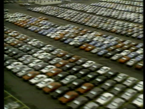 stockvideo's en b-roll-footage met recession / chrysler ms honda car on motor show stand with female models next cms car airv thousands of new unsold cars lined up in compound airv... - chrysler