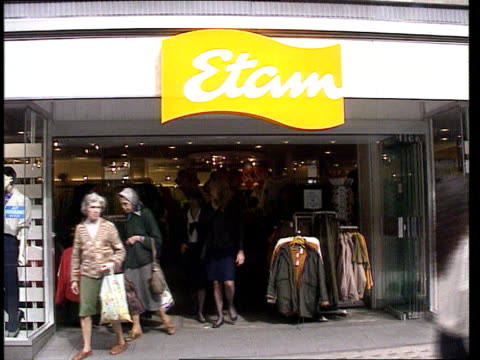recession continues england gv etam shop gv dixons shop int ms shoppers inside dixons ext gv 'next' shop int cms assistant and shoppers in ladies... - recession stock videos & royalty-free footage