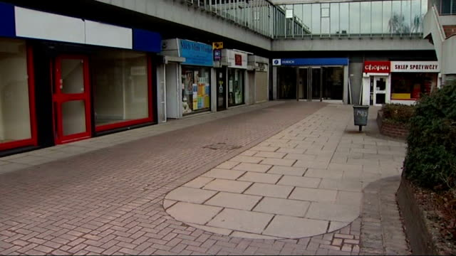 councils' 'ghost town' warning over empty shops; england: surrey: sutton: ext shoppers past closed down and empty shops in shopping centre 'to let'... - danger stock videos & royalty-free footage