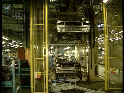 recession depens tyne wear lms cars on nissan production line tilt up washington lms ditto nissan cms woman working on car production line factory... - rezession stock-videos und b-roll-filmmaterial