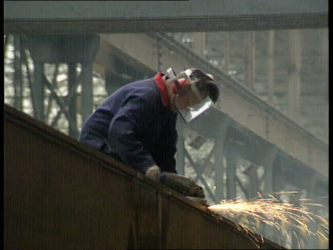 recession leicester int lms welder at work pull out another ditto in f/g la ms worker sanding metal beam cms welder wearing protective mask cms david... - recession stock videos & royalty-free footage