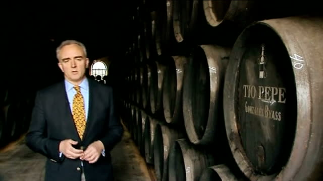 Report on unemployment in Jerez SPAIN Jerez SHOT past barrels of Tio Pepe sherry stacked up in storage warehouse Close shot 'Tio Pepe' name on barrel...
