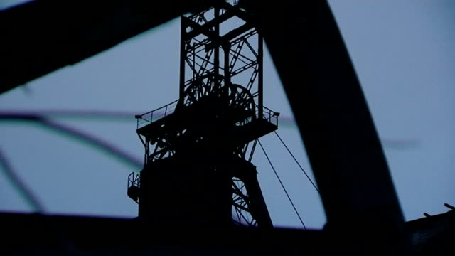 Ukraine Silhouette of steel works and slag heap at coal works