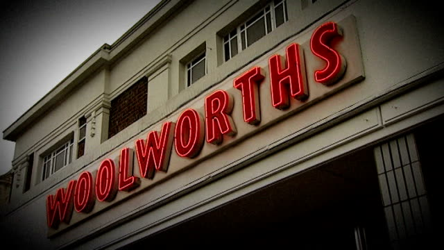woolworths and mfi go into administration; england: london: ext graphicised sequence woolworths sign disappearing from top of store - recession stock videos & royalty-free footage