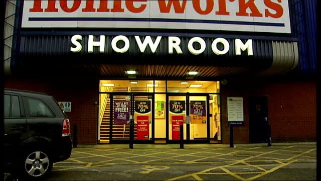 vídeos de stock, filmes e b-roll de woolworths and mfi go into administration mfi store england london stamford hill ext sign over entrance to mfi homeworks store / we'll fit it for... - woolworths